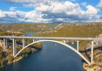 Aerial panorama view with bridge and sea around islands. Beautiful landscape surrounded with blue sea with bridge.,Aerial panorama view with bridge and sea around islands. Beautiful landscape surrounded with blue sea with bridge.
