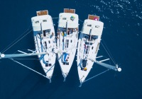 Aerial view of yacht sailing near beautiful Islands. Beautiful clouds in the background. Luxury yacht in the sea.,Aerial view of yacht sailing near beautiful Islands. Beautiful clouds in the background. Luxury yacht in the sea.
