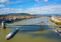 Aerial footage from a drone shows the historical Buda Castle near the Danube on Castle Hill in Budapest, Hungary. Bridge on the river. Aerial view.,Aerial footage from a drone shows the historical Buda Castle near the Danube on Castle Hill in Budapest, Hungary. Bridge on the river. Aerial view.